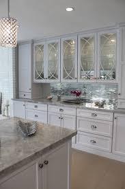 mirrored tile backsplash kitchen contemporary with modern glass
