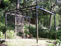 Image Of Pergola by A Steel Hoop Arbor And A Pergola Frame Draped With Canvas Create A