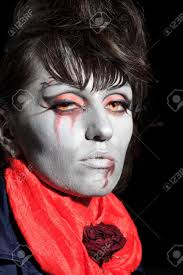 woman as a vampire halloween face art stock photo picture and