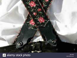 embroidery and decorations on the suspenders of lederhosen stock