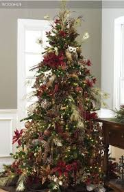 this tree has glitter peacock feathers and leopard ornaments on