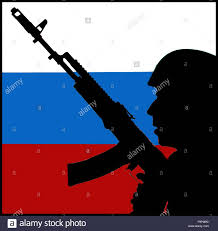 Eussian Flag Soldier With A Submachine Gun And Russian Flag Stock Photo