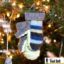 rolled paper christmas tree ornament her tool belt