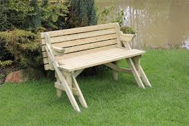 lifetime small convertible picnic bench made from wood on green