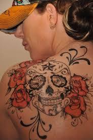 roses and sugar skull on left back shoulder