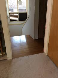 Grey Laminate Wood Flooring Help With Solid Oak Hallway Next To Gray Laminate Wood Floor