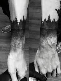 black ink pine trees on wrist