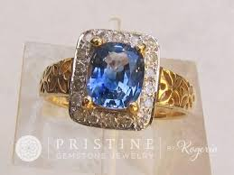blue sapphire art deco ring in 14k gold diamond halo