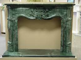 fireplace box surrounding at carved green marble fireplace mantel