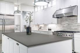 grey kitchen cabinets with white countertop white cabinets with gray countertops add depth to your