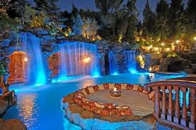 Extravagant Backyards - amazing pools with waterfalls ideas pool grotto bridge seating