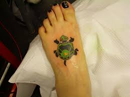 green and black ink turtle on left