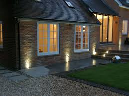 create a safe and welcoming winter home with outdoor lighting from