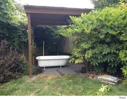 Outside Bathtubs Use A Salvaged Tub To Turn Your Backyard Into A Soothing Oasis