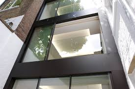 Sliding Patio Door Track by For Minimal Windows On The Upper Floors We Fixed A Frameless Glass