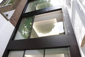 sliding glass door tracks for minimal windows on the upper floors we fixed a frameless glass