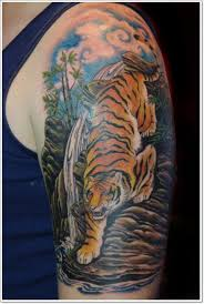 stunning painted and colored realistic tiger near waterfall tattoo