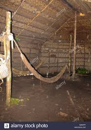 inside a maloca matses traditional house amazon peru stock