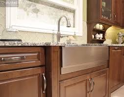 kraftmaid s new hazel stain showcases a wood s natural grain cherry kitchen in hazel