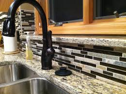 delta oil rubbed bronze faucet backsplash is glass and stone mc