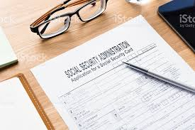 social security card application form on table stock photo