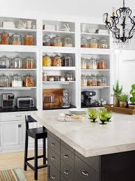 kitchen with white countertops and glass canisters pretty glass