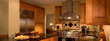 kitchen islands with cooktop brown tile backsplash pattern with ventahood also cooktop and