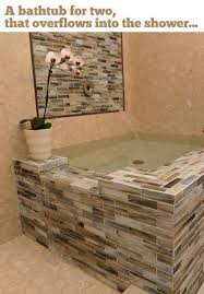 a bathtub for two that overflows into the shower pictures photos