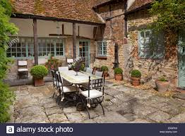 outdoor courtyard outdoor garden terrace eating area in courtyard of house england