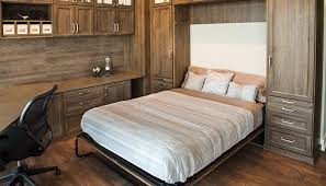 room with hidden fold away desk and murphy style bed