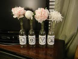 Cheap Easy Wedding Centerpieces by Another Centerpiece Idea After Spray Painting The Wine Bottles