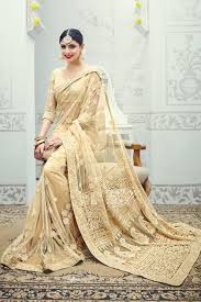 bige color beige color designer net party wear saree with heavy work from