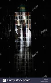 a beaded curtain hanging in front of a doorway stock photo