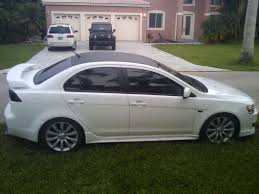 silver mitsubishi lancer black rims vinyl roof wrap evolutionm mitsubishi lancer and lancer