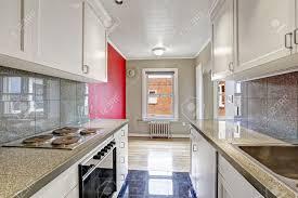 gray kitchen cabinets with white trim white kitchen cabinets with grey tile wall trim and tile floor