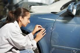 color match auto paint colourist woman matching paint of car element at automobile repair