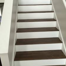 luxury vinyl plank on stairs with white risers vinyl floors