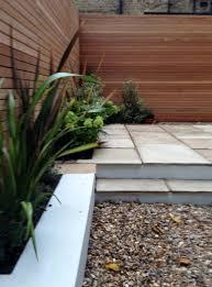 clapham london garden design sandstone paving hardwood privacy