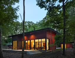 this light filled metallic home embraces its wooded site dwell this light filled metallic home embraces its wooded site dwell carrboro house metal exterior inexpensive home decor