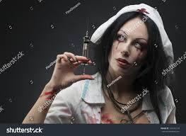 dead nurse holding syringe blood stock photo 124151116 shutterstock