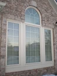 tips ideas rustic wooden pella windows plus wooden wall for white arch bay pella windows matched with brick wall ideas