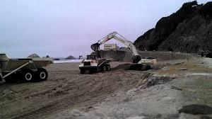san francisco ocean beach sand management project trucks and