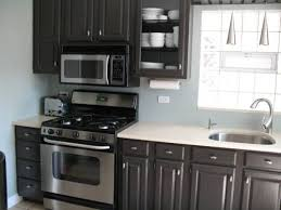 black kitchen cabinets and gray walls video and photos