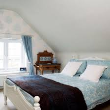 cottage attic bedroom ideas sloping ceiling window rattan blinds