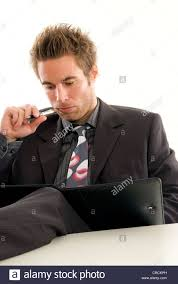 Feet On The Desk Reflecting Young Businessman With His Feet On The Desk Stock Photo