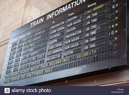 Massachusetts travelers stock images A schedule board in a train station with information telling the jpg