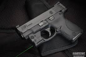 smith and wesson m p 9mm tactical light viridian reactor 5 green laser sight review s w shield handguns