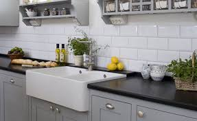 solid surface farmhouse sink black solid surface countertop farmhouse sink subway tile