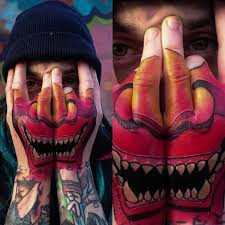 hannya face mask on guys hands best tattoo design ideas