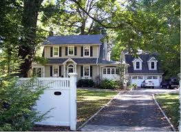 roots of style dutch colonial homes settle on the gambrel roof